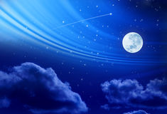 Full Moon Night Sky Stars. A full moon in a night sky with stars and clouds Stock Image