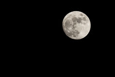 Full moon in the night sky in winter Royalty Free Stock Photo