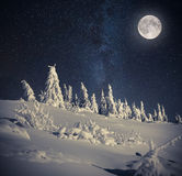 Full moon in night sky in winter mountains Royalty Free Stock Image