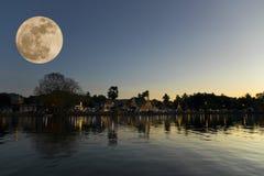 Full moon in night time fo Wat Jong Kham and Jong Klang at Mae Hong Son province, Thailand.  royalty free stock photo