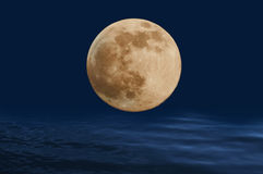 Full Moon on the ocean waves. Stock Photography