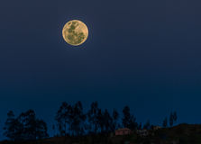 Full Moon Over the Andes, Cuenca, Ecuador. A full moon as it rises above the Andes mountains near the city of Cuenca, Ecuador Royalty Free Stock Images