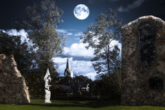 Full moon over an angel statue Royalty Free Stock Image