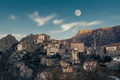 Full moon over Balagne village of Speloncato in Corsica Royalty Free Stock Photo