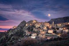 Full moon over Balagne village of Speloncato in Corsica Stock Photo