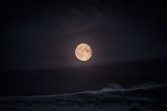 Full moon over beach Royalty Free Stock Photo