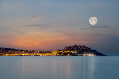 Full moon over Calvi citadel in Balagne region of Corsica Royalty Free Stock Image