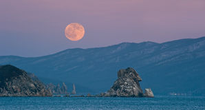 Full moon over the Cape Laplace. Full Moon who ascended the coast after sunset. Japan Sea Royalty Free Stock Photos