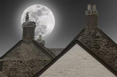 Full moon over the chimneys stock photos