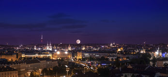 Full moon over city, Prague at night. Stock Photos