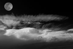 Full moon over the clouds. BW Royalty Free Stock Photo