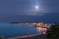 Full moon over the coastal city Royalty Free Stock Photography