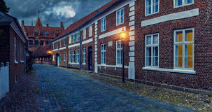 Full moon over the cobblestone street of the old town Stock Photos