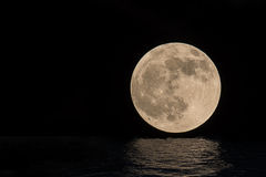 Full moon over. Cold night water for your design space Stock Image