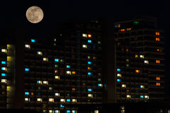 Full moon over colorful windows of residential house Royalty Free Stock Photography