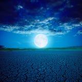 Full moon over desert Royalty Free Stock Images