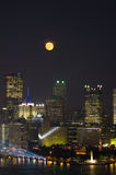 Full Moon Over Downtown Building Stock Photo