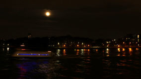 Full moon over East River with boat and city lights royalty free stock images