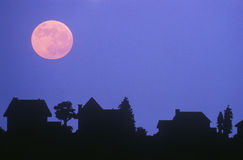 Full moon over family homes Royalty Free Stock Images