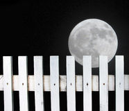 Full moon over the fence stock photos