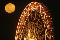 Full moon over Ferris Wheel Royalty Free Stock Photo