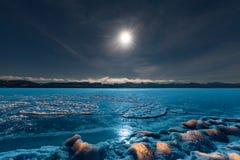 Full moon over frozen Lake Laberge Yukon Canada royalty free stock images