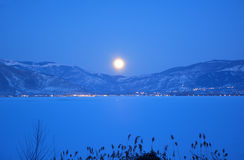 Full moon over the frozen lake Royalty Free Stock Photo
