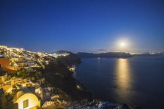 Full moon over Imerovigli. Town on Santorini island, Greece Stock Photo