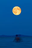Full moon over the lake on the beach Stock Photo