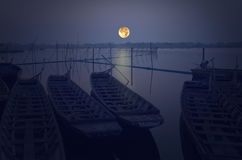 Full moon over the lake in the evening Royalty Free Stock Image