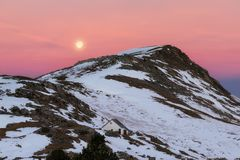Full moon over Larra covered by snow stock photos