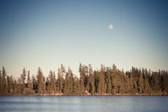 Full moon over mountain lake Stock Photos