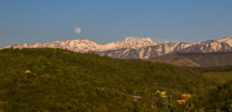 Full moon over the mountains landscape near Talgar peak, Tien-Sh Royalty Free Stock Images