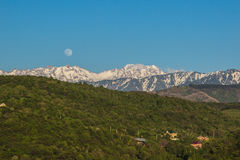 Full moon over the mountains landscape near Talgar peak, Tien-Sh Stock Image
