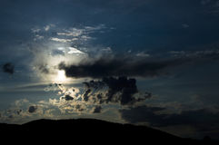 Full moon over the mountains, overcast night sky Royalty Free Stock Photo