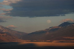 Full moon over the mountains and the sunset. In the Altai Mountains, Chui steppe Stock Photography