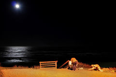 Full moon over Newport Beach. A photographer composes a shot of a full moon over Newport Beach Oregon Stock Photos