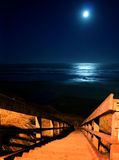 Full moon over Newport Beach. A full moon over Newport Beach Oregon with a wooden stairway in the forground Royalty Free Stock Photography