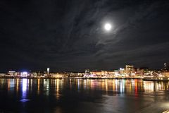 Full moon over North Harbour. A magical full moon shines over Lule Stock Photo