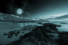 Full moon over the ocean. In Nequay, Cornwall, UK Royalty Free Stock Photo