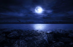 Full moon over the ocean. With clouds and rocks Royalty Free Stock Photo