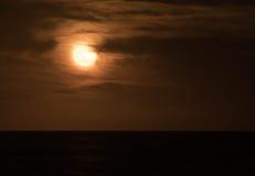 Full moon over the ocean Stock Photos