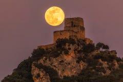Full moon over Ocio castle. In Alava royalty free stock image