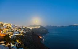 Full moon over Oia. A full moon over Oia on Santorini island Stock Photos