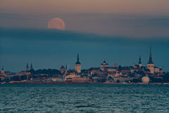 Full moon over Old town of Tallinn city Royalty Free Stock Images