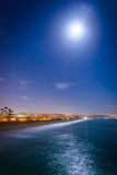 A full moon over the Pacific Ocean at night. A full moon over the Pacific Ocean at night, seen from Balboa Pier in Newport Beach, California Royalty Free Stock Photos