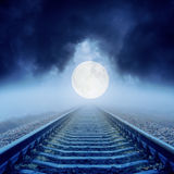 Full moon over railroad in clouds Stock Image