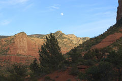 Full moon over red rocks Stock Photo