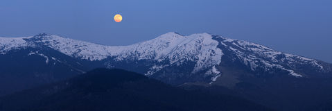 Full moon over the ridge in the Carpathians royalty free stock images