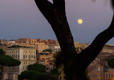 Full moon over Rome Stock Images